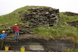 South Howe broch being cleaned -the faced entrance passage is on the right