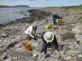 Excavation at the new Late Bronze Age site emerging from the beach at Swandro